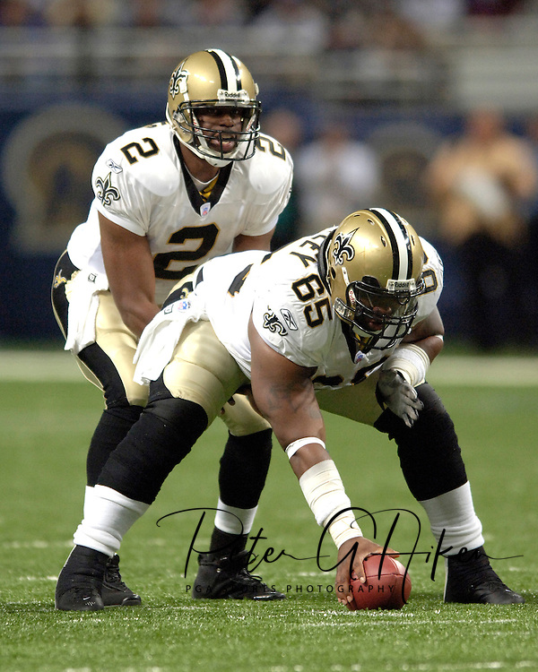 Saints center LeCharles Bentley (65) gets ready to snap the ball the quarterback Aaron Brooks (2) during game action against St. Louis at the Edward Jones Dome in St. Louis, Missouri, October 23, 2005.  The Rams beat the Saints 28-17.
