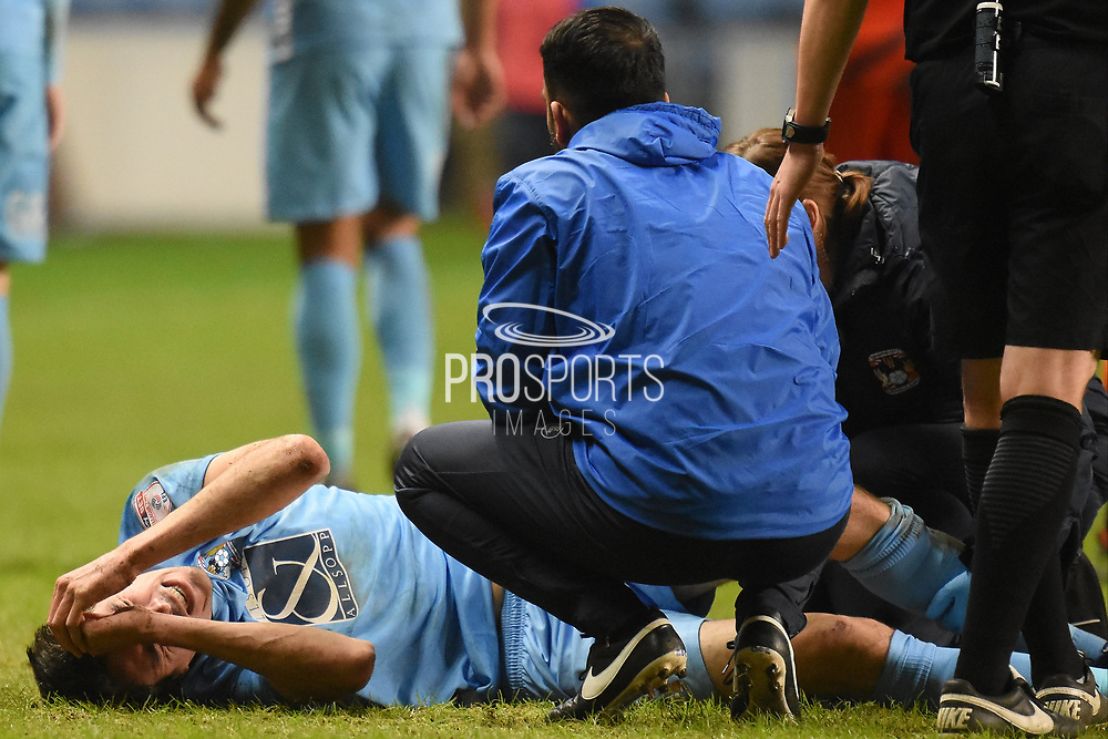 Coventry City midfielder Peter Vincenti (7) in pain and is substituted 2-0 during the EFL Sky Bet League 2 match between Coventry City and Wycombe Wanderers at the Ricoh Arena, Coventry, England on 22 December 2017. Photo by Alan Franklin.