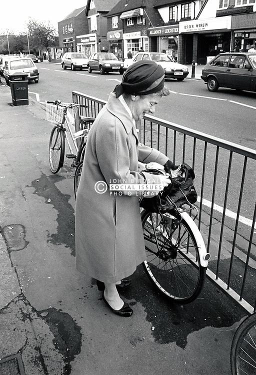 Elderly woman with bicycle, Nottingham, UK 1989
