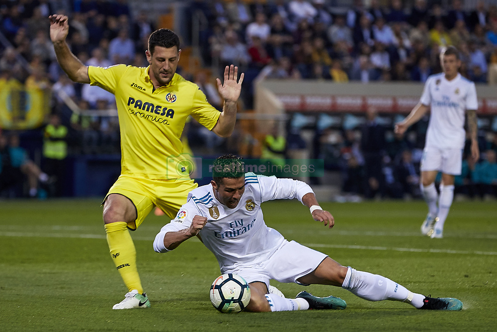 May 19, 2018 - Vila-Real, Castellon, Spain - Cristiano Ronaldo (R) of Real Madrid CF competes for the ball next to Daniele Bonera of Villarreal CF during the La Liga game between Villarreal CF and Real Madrid CF at Estadio de la Ceramica on May 19, 2018 in Vila-real, Spain  (Credit Image: © David Aliaga/NurPhoto via ZUMA Press)