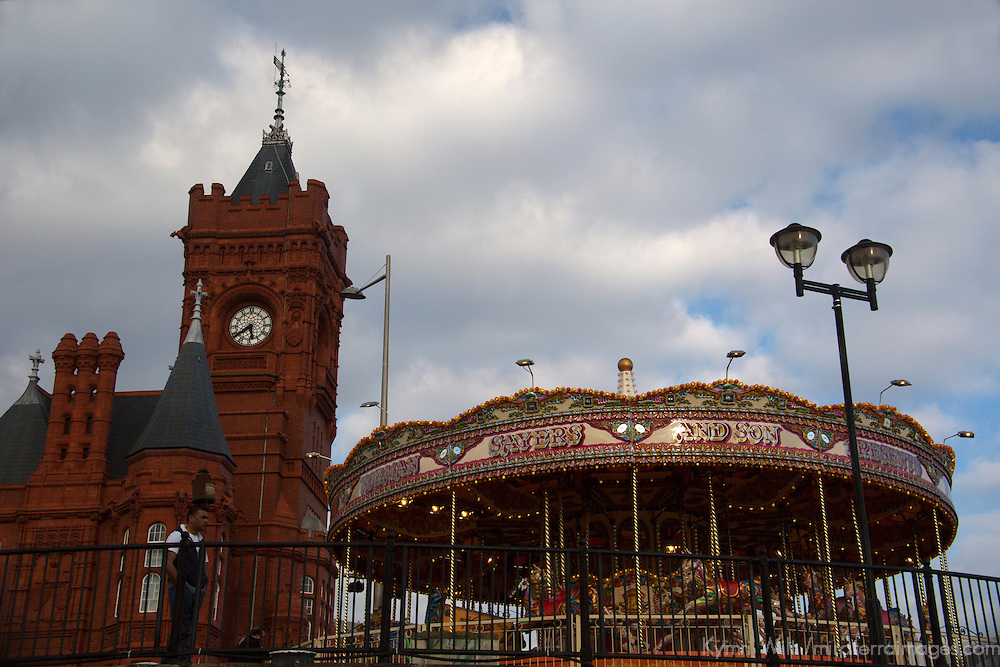 Europe, United Kingdom, Wales, Cardiff.  The Pierhead Building and Welsh Theme Carousel at Cardiff Bay.