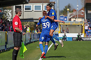 AFC Wimbledon defender Toby Sibbick (20) celebrates with AFC Wimbledon striker Joe Pigott (39) after goal during the EFL Sky Bet League 1 match between AFC Wimbledon and Bristol Rovers at the Cherry Red Records Stadium, Kingston, England on 19 April 2019.