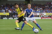 Burton Albion midfielder Scott Fraser and Ipswich Town midfielder Flynn Downes during the EFL Sky Bet League 1 match between Burton Albion and Ipswich Town at the Pirelli Stadium, Burton upon Trent, England on 3 August 2019.