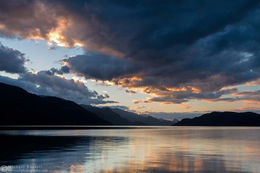 Late spring sunset over Harrison Lake, the Coast Range and Echo Island from Harrison Hot Springs, British Columbia, Canada