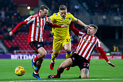 James Clarke of Bristol Rovers is tackled by Max Power of Sunderland - Mandatory by-line: Robbie Stephenson/JMP - 15/12/2018 - FOOTBALL - Stadium of Light - Sunderland, England - Sunderland v Bristol Rovers - Sky Bet League One