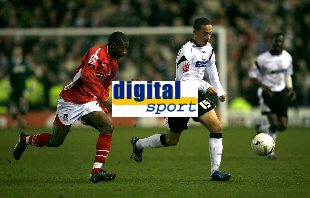 Ryan Smith of derby County (white, right) is chased by Wrexham defender Josh Johnson (red, left)