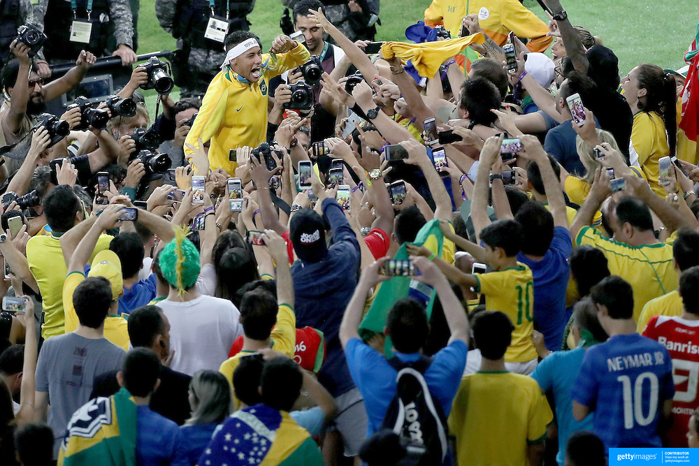 Football - Olympics: Day 15  Neymar #10 of Brazil showing his medal to supporters in the crowd after Brazil won a penalty shoot out during the Brazil Vs Germany Men's Football Gold Medal Match at Maracana on August 20, 2016 in Rio de Janeiro, Brazil. (Photo by Tim Clayton/Corbis via Getty Images)