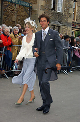 HUGH & ROSE VAN CUTSEM at the wedding of Laura Parker Bowles to Harry Lopes held at Lacock, Wiltshire on 6th May 2006.<br />
