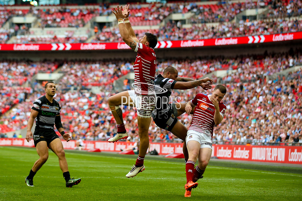 Hull FC left wing Fetuli Talanoa (5) is blocked off by Wigan Warriors right wing Marshall (35)  during the Ladbrokes Challenge Cup Final 2017 match between Hull RFC and Wigan Warriors at Wembley Stadium, London, England on 26 August 2017. Photo by Simon Davies.