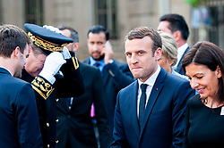 © Licensed to London News Pictures. FILE PICTURE 14/05/2017 Hôtel de Ville, Paris, France. Alexandre Benalla (centre rear) pictured with president Emmanuel Macron at his inauguration after being elected to office alongside Mayor Anne Hidalgo (R). Mr Benalla, a close security aide to Mr Macron, is facing disciplinary action after damning video evidence emerged of him assaulting demonstrators at a May Day demonstration while wearing a CRS riot helmet and a police armband - an ever present shadow to Mr Macron, Benalla continued to serve in his capacity as a security advisor and bodyguard following a light reprimand from the Elysee while the mounting scandal and accusations of an attempted cover up escalated. Macron called an emergency meeting on Sunday to manage the crisis, while Benalla was arrested and remanded in custody over the weekend on charges of violence by a public official, impersonating a police officer and the illegal use of police insignia. Benalla was due to be getting married on Saturday. Macron's popularity ratings fell to an all time low of 39% last week, quashing hopes that the World Cup win would give him a boost. Photo credit: Guilhem Baker/LNP