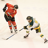 5th year forward Stephen Langford (21) of the Regina Cougars in action during the Men's Hockey home game on February 3 at Co-operators arena. Credit: Arthur Ward/Arthur Images