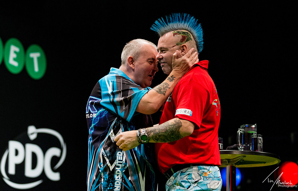 MELBOURNE, Australia - Sunday 20 August 2017: Peter Wright congratulates Phil Taylor on winning the final of the Unibet Melbourne Dart Masters at Hisense Arena on Sunday 20 August 2017.<br /> <br /> Photo Credit: Tim Murdoch/Tim Murdoch Photography
