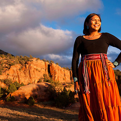 Kayla Begay stands in front of Fuzzy Mountain in Navajo, N.M.