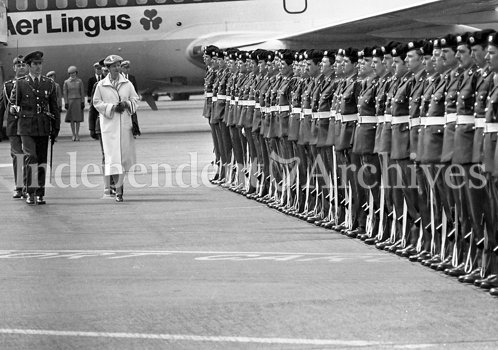 Queen Margrethe of Denmark inspecting the Guard of Honour drawn from the 5th Infantry Battalion, Collins Barracks at Dublin Airport prior her departure, 27/04/1978 (Part of the Indeoendent Newspapers Ireland/NLI Collection).