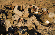 A Marine catches some shut-eye while Echo Company waits for bison to clear the firing range during live-fire exercises for the 2nd Battalion, 5th Marine Regiment at Camp Pendleton.<br /> <br /> <br /> ///ADDITIONAL INFO:   <br /> <br /> david.marines.0705.kjs  ---  Photo by KEVIN SULLIVAN / Orange County Register  --  6/28/13<br /> <br /> Live-fire exercises by the United States Marine Corps' 2nd Battalion, 5th Marine Regiment  (2/5) based out of Marine Corps Base Camp Pendleton, California. The 2/5 fall under the command of the 5th Marine Regiment and the 1st Marine Division.<br /> <br />   6/28/13.