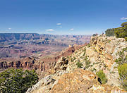 Grand Canyon south rim wide angle view from Pipe Creek Vista with Colorado River , Arizona USA, April 2014. Tiny unrecognizable people show the grand scale of this national landmark.