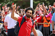 Liverpool striker Mohamed Salah (11) salutes and waves at the fans and supporters during the Manchester United and Liverpool International Champions Cup match at the Michigan Stadium, Ann Arbor, United States on 28 July 2018.