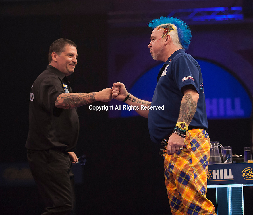 01.01.2014.  London, England.  William Hill PDC World Darts Championship.  Quarter Final Round.  Gary Anderson (4) [SCO] and Peter Wright (5) [SCO] before their quarter final game