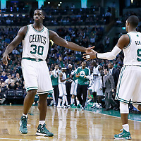 16 January 2013: Boston Celtics point guard Rajon Rondo (9) is congratulated by Boston Celtics power forward Brandon Bass (30) during the New Orleans Hornets 90-78 victory over the Boston Celtics at the TD Garden, Boston, Massachusetts, USA.