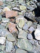 River rocks along the Shotover River, Skippers Canyon, near Queenstown, Otago, New Zealand; home of the original New Zealand gold rush.