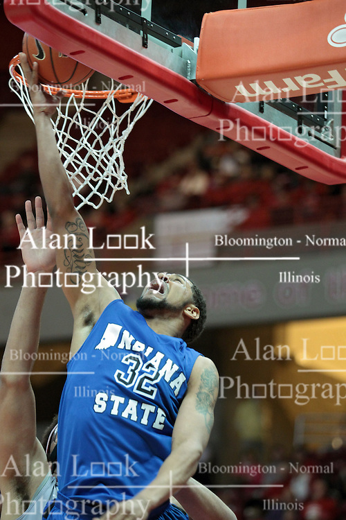 26 February 2014:  Khristian Smith lays up the ball to the far side of the basket getting past Reggie Lynch during an NCAA Missouri Valley Conference (MVC) mens basketball game between the Indiana State Sycamores and the Illinois State Redbirds  in Redbird Arena, Normal IL.
