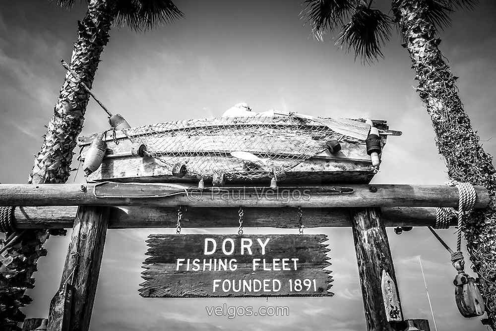 Dory Fishing Fleet black and white picture in Newport Beach California. Dory Fish Market is a historic landmark located on Balboa Peninsula in Newport Beach, Orange County, California.
