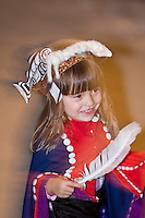 A young Namgi's dancer in Alert Bay dances the welcome dance for visitors to the longhouse on their reserve.  Alert Bay, Northern Vancouver Island, British Columbia, Canada.