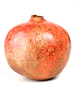 Close-up of pomegranate on white background