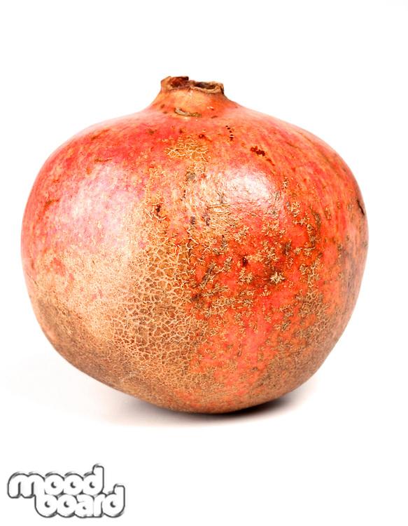 Close-up of pomegranate on white background