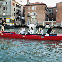 "VENICE, ITALY - OCTOBER 01:  Musicians play while on a traditional Venetian boat during the ""Vogata Rituale - Cultura in Memoriam"" heading towards San Michele Cemetery on October 1, 2011 in Venice, Italy.  Vogata Rituale - Cultura in Memoriam is part of the 55. Festival Internazionale di Musica Contemporanea organised by the Biannale."