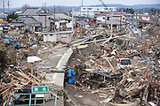 Debris covers the smashed railway station and tracks at Tona, Higashimatsushima, Miyagi Prefecture, Japan on  18 March 2011. .Photographer: Robert Gilhooly
