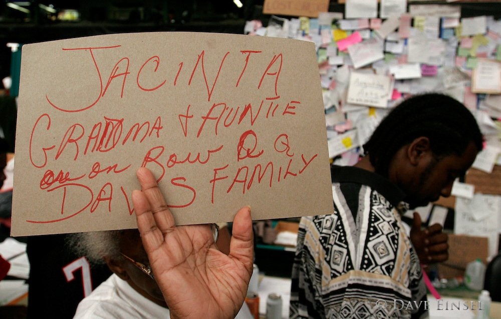 HOUSTON - September 3: Sadie Davis, of New Orleans, holds a sign as she searches for family members in the Reliant Astrodome Saturday, Sept. 3, 2005. Houston's Reliant Astrodome is filled to capacity as are many other area shelters.<br />