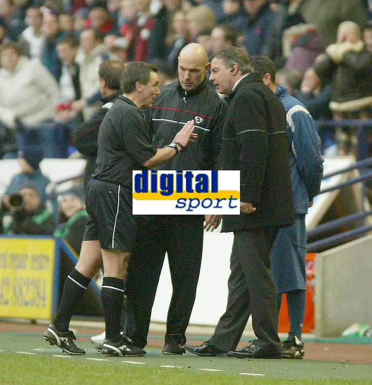 Photo. Andrew Unwin.<br /> Bolton Wanderers v Liverpool, Barclaycard Premier league, Reebok Stadium, Bolton 07/02/2004.<br /> Bolton's Sam Allardyce (r) has a heated discussion with the referee, Mr A Wiley (l).