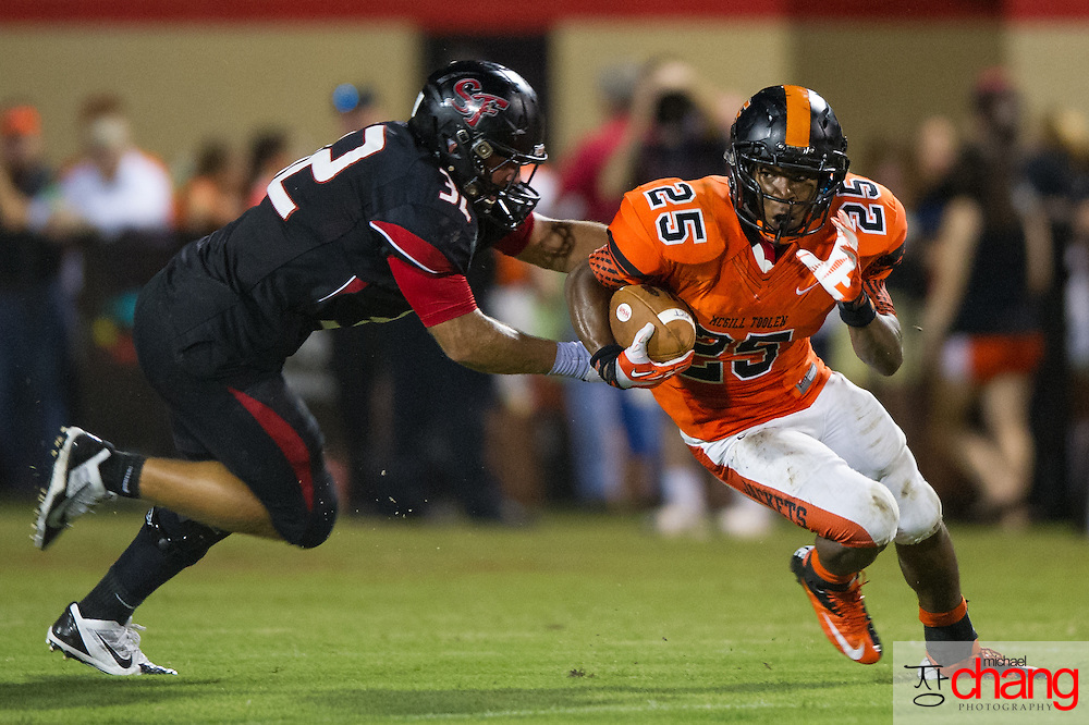 McGill-Toolen's Blake Arceneaux (25) runs past Spanish Fort's JD Campbell (32) during the first half of play at Spanish Fort's football stadium Friday, Aug. 23, 2013, in Spanish Fort, Ala. At halftime the McGill-Toolen Yellow Jackets lead the Spanish Fort Toros 12-10. (Press-Register, Michael Chang) SPORTS
