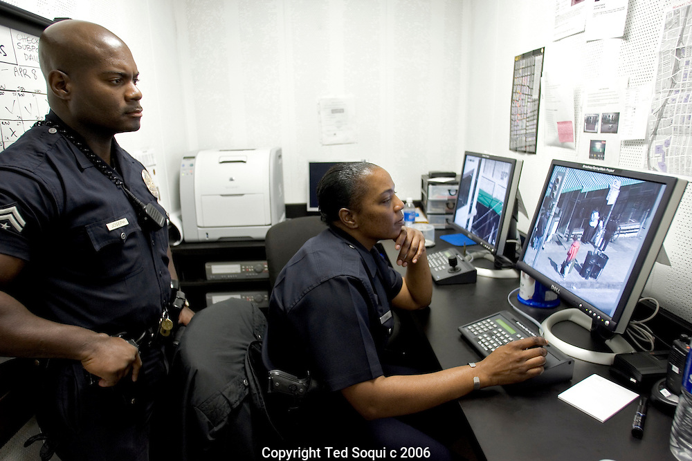 LAPD Senior Lead officer Deon Joseph and Officer Banks (sitting) working remote cameras placed in LA's Downtown Skid Row. They monitor and record illegal activity then dispatch officers to make arrest..LAPD Central Division Station.