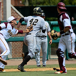 June 04, 2011; Tallahassee, FL, USA; Bethune-Cookman Wildcats pitcher Rayan Gonzalez (36) tags out UCF Knights designated hitter D.J. Hicks (42) in a run down during the first inning of the Tallahassee regional of the 2011 NCAA baseball tournament at Dick Howser Stadium. Mandatory Credit: Derick E. Hingle