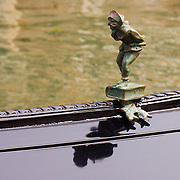 Bronze or brass mariner figure decoration on gondola, Venice, Italy<br />