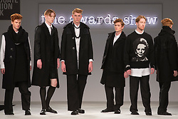 © Licensed to London News Pictures. 03/06/2014. London, England. Margaret Thatcher-themed award-winning collection by Aimee Dunn from Nottingham Trent University who received the Menswear Award. Graduate Fashion Week 2014 concludes with the awards show at the Old Truman Brewery in London, United Kingdom. Photo credit: Bettina Strenske/LNP