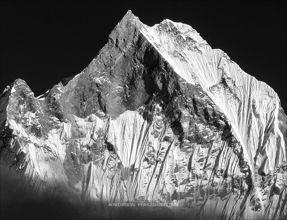 "Machapuchare 6,993m (22,943ft), West Face from Annapurna Base Camp, Nepal.  Sacred to the god Shiva, the peak is forbidden to climbers, and has never officially been summited.  It is commonly known as the ""Matterhorn of Nepal"" or the ""Fish's Tail"".  Nikon F90, 80-200/2.8, Agfa CT100.  Photo: 2 November 1993."