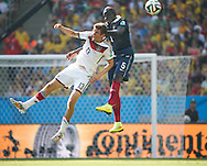 Thomas Muller of Germany (L) is challenged by Mamadou Sakho of France (R) during the 2014 FIFA World Cup match between France and Germany at the Maracana Stadium, Rio de Janeiro<br /> Picture by Andrew Tobin/Focus Images Ltd +44 7710 761829<br /> 04/07/2014