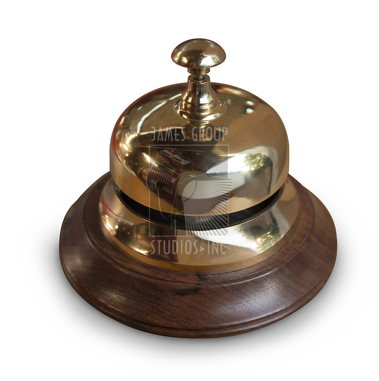 brass service desk bell with wood base, isolated on white with clipping path