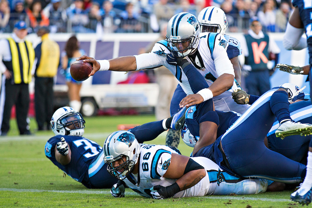 NASHVILLE, TN - NOVEMBER 15:  Cam Newton #1 of the Carolina Panthers holds the ball out over the goal line for a touchdown while being tackled by Angelo Blackson #95 and Wesley Woodyard #59 of the Tennessee Titans at Nissan Stadium on November 15, 2015 in Nashville, Tennessee.  (Photo by Wesley Hitt/Getty Images) *** Local Caption *** Cam Newton; Wesley Woodyard; Angelo Blackson