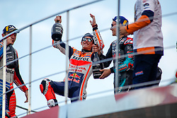 November 17, 2019, Cheste, VALENCIA, SPAIN: Marc Marquez, rider of Repsol Honda Team from Spain, celebrates the victory and the World Champion Title during the podio after the MotoGP Race with Jack Miller, rider of Pramac Racing from Australia, (Left and Thrid in the Race) and Fabio Quartararo, rider of Petronas Yamaha SRT from France, (Right and Second in the Race) of the Valencia Grand Prix of MotoGP World Championship celebrated at Circuit Ricardo Tormo on November 16, 2019, in Cheste, Spain. (Credit Image: © AFP7 via ZUMA Wire)