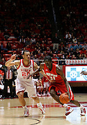 New Mexico guard Tony Snell (21) drives down the court as Utah forward J.J. O'Brien (20) defends during an NCAA college basketball game, Wednesday, Jan. 19, 2011, in Salt Lake City. (AP Photo/Colin E Braley)