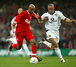 CARDIFF, WALES - Sunday, March 2, 2003: Liverpool's El-Hadji Diouf and Manchester United's Mikael Silvestre during the Football League Cup Final at the Millennium Stadium. (Pic by David Rawcliffe/Propaganda)