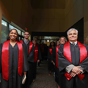 From Left: Ms Erica Holt Assistant Head of school and Head of School Mr. Charles Hughes and faculty prepare for a Academic processional prior to D.A.P.S.S inaugural commencement exercise Friday, June 05, 2015, at The Case Center on The River Front in Wilmington, Delaware.