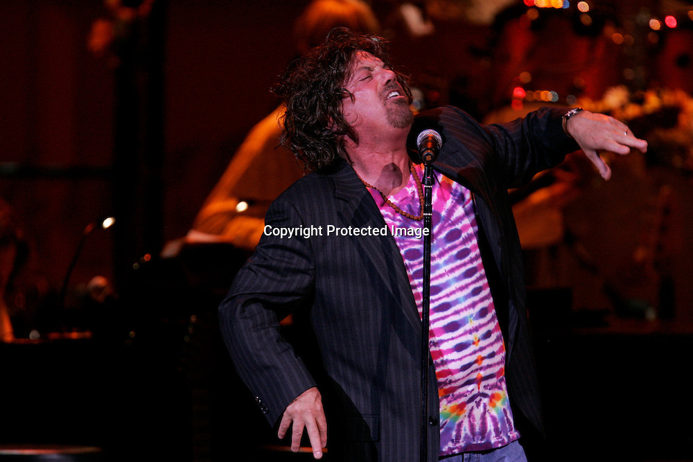 Singer Billy Joel imitates rocker Joe Cocker as he performs during the Rainforest Foundation's benefit concert at Carnegie Hall in New York May 19, 2006. Photo by Keith Bedford