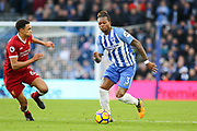 Brighton and Hove Albion defender Gaetan Bong (3) battles with Liverpool defender Trent Alexander-Arnold (66) during the Premier League match between Brighton and Hove Albion and Liverpool at the American Express Community Stadium, Brighton and Hove, England on 2 December 2017. Photo by Phil Duncan.