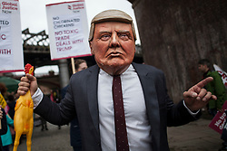 © Licensed to London News Pictures. 01/10/2017. Manchester, UK.  A protester dress as Donald Trump at the National Demonstration Against Austerity as part of the Take Back Manchester festival to protest the Conservative Party conference taking part in the city.  Photo credit: Steven Speed/LNP