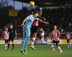 Tranmere Rovers's Josh Thompson and Exeter City's Clinton Morrison challenge for the header - Photo mandatory by-line: Dougie Allward/JMP - Mobile: 07966 386802 - 31/01/2015 - SPORT - Football - Exeter - St James Park - Exeter City v Tranmere Rovers - Sky Bet League Two